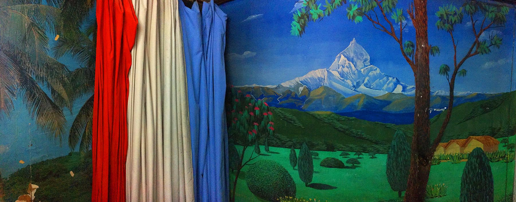 Photography studios in Nepal use aspirational backdrops, such as an idealised landscape, to allow people to shed their day-to-day identities and imagine a different life.