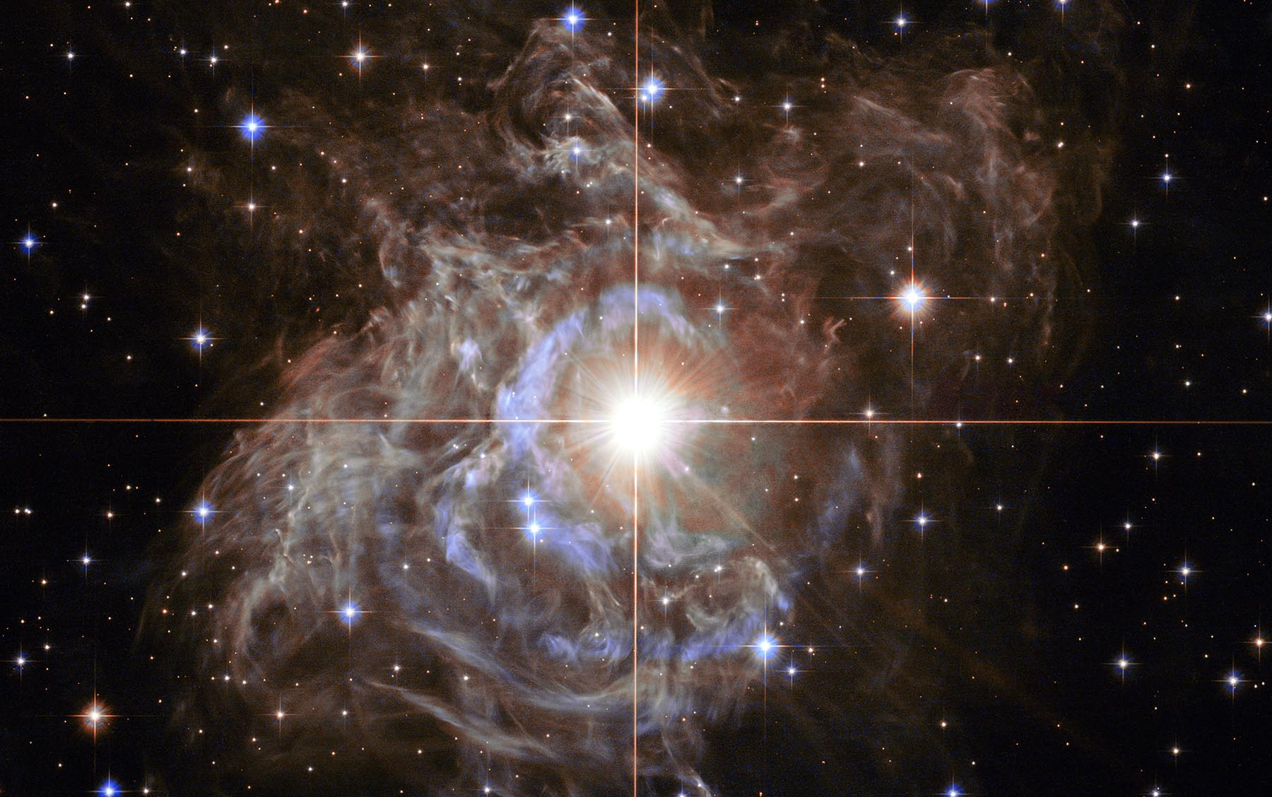 At the centre of the image is an important star called the RS Puppis, a Cepheid variable star which is a class of stars whose luminosity is used to estimate distances to nearby galaxies. This one is 15,000 times brighter than our sun.