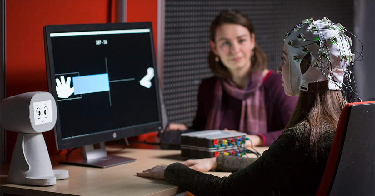 A robotic companion called PEANUT provides brain-computer interface users with social feedback, such as encouragement, while they use the system. Image credit - Inria/C. Morel